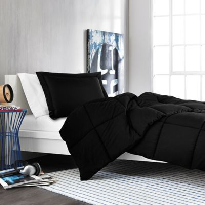 outfit your bed in classic style with the plush solid comforter set dressed in all black the ultra soft fabric is treated with micro ban antimicrobial