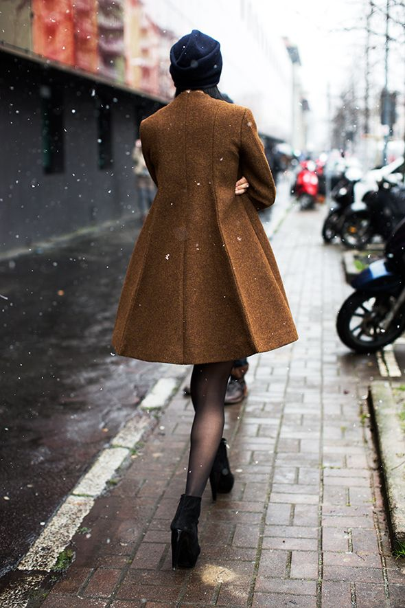 A coat with flare, I like it. From the Sartorialist.