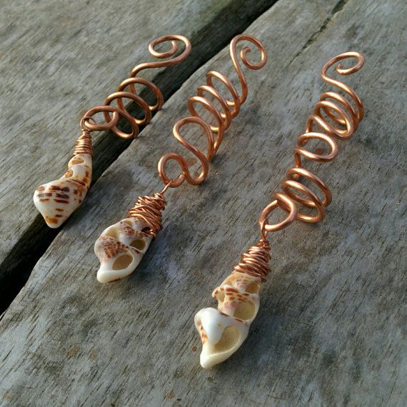 Free shipping for orders more than $18, use coupon code FreeD, valid till August 31 2017! Copper wire dread bead with real sea shell from Andaman Sea. This listing is for one bead, please select size you want. Easily fit for your hair, braids or dreads. Every hair bead is 100% unique, sea shell may vary. Three sizes available. Total length (approximately): S - 2 1/4 6cm M - 2 3/4 8cm L - 3 1/4 9cm Hole diameter 8 mm. Dreadlock bead is covered with best quality wax to prevent...