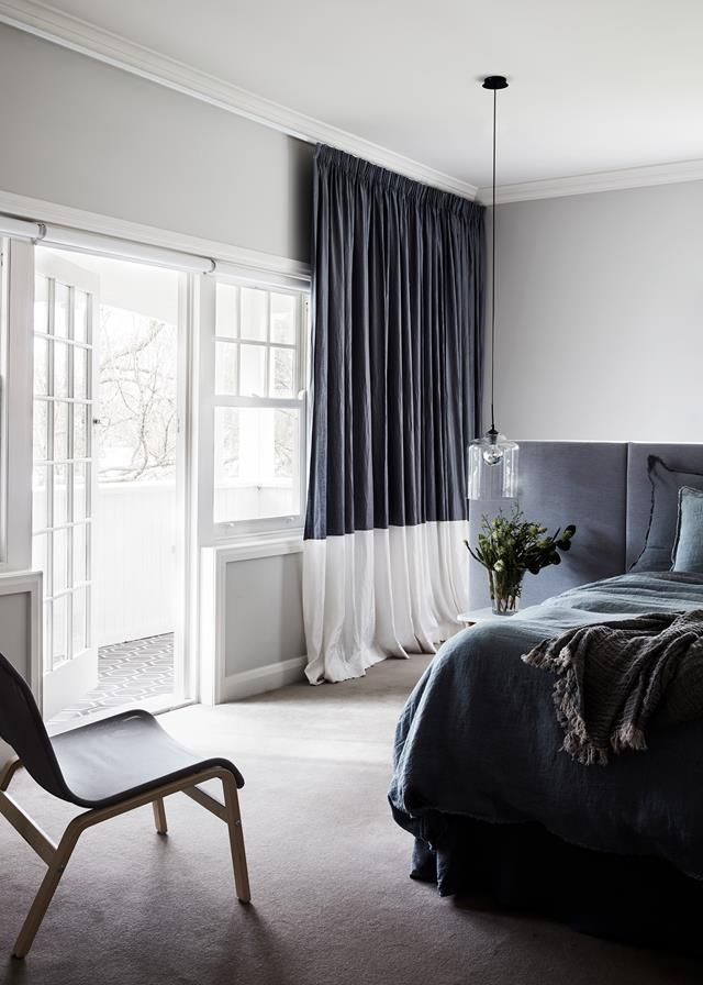 This dramatically styled master bedroom manages to feel light and airy despite furniture in darker shades. Dual toned curtains add to the balance of dark/light in this restored Edwardian home. Photography: Sean Fennessy   Styling: Heather Nette King   Story: Belle