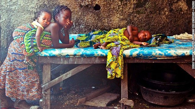 """Imole """"Tobbie"""" Balogun was another grand-prize winner. His photo highlights the overwhelming responsibility many of Nigeria's impoverished children face, either because they're forced to work or take over family duties at an early age."""