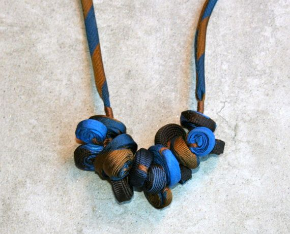 Light necklace suitable for all occasion.  Handmade with recycled neckties and wood button.