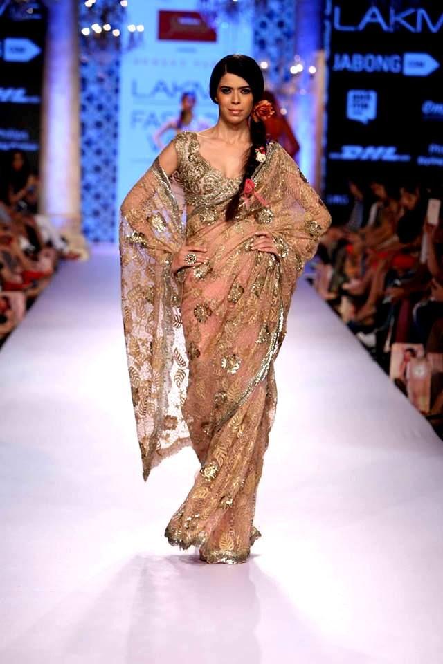 Make heads turn in this embellished #beige #SuneetVarma saree at #LakmeFashionWeek #SpringSummer15