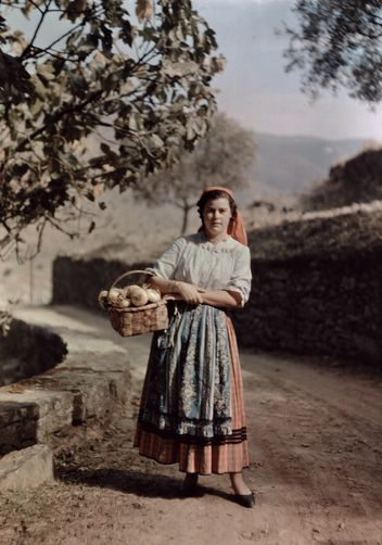 Autochrome: W. Robert Moore. A girl holds a basket of onions. Douro River Valley, Portugal.