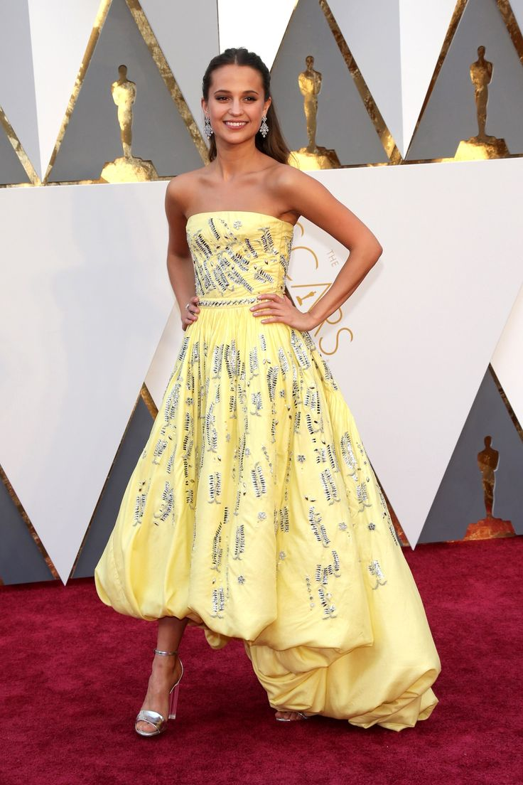 Oscars 2016: Alicia Vikander in Louis Vuitton lemon yellow dress - click through to see the full gallery....