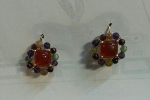 Flowers. Earrings in18kt yellow gold carneliam and semiprecious gems hand made in Italy by Diogenes orafo www.diogenesarte.com