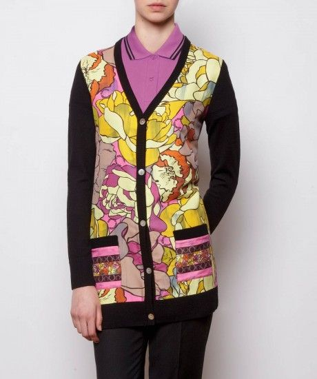 Longline merino knit cardigan, cut with a slim fit and a silk blend panel to the front complete with a vintage inspired floral print. Finished with a fine rib detail at the hem and cuffs. Team this standout print with narrow trousers and black leather bro