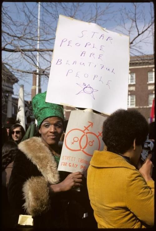 """1970s-marsha-p-johnson-Marsha P. Johnson co-founded Street Transvestite Action Revolutionaries (S.T.A.R) with Sylvia Rivera, where she was known as the house """"mother,"""" and was one of the leaders in clashes with police at the Stonewall Riots."""