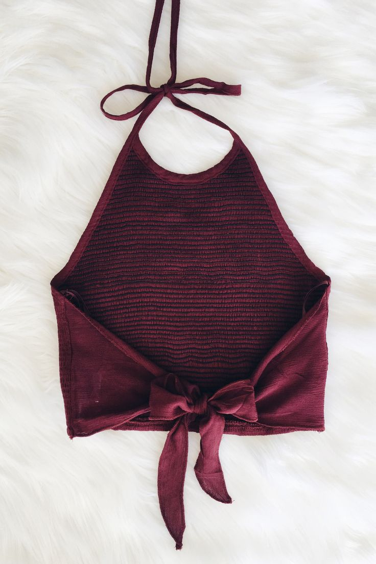 """- Details - Size - Shipping - • 100% Rayon • Self tie crop halter top. • Hand Wash • Line dry • Imported • Measured from small • Length 10"""" • Chest 13.5"""" • Waist 11.5"""" - Free domestic shipping on U.S."""