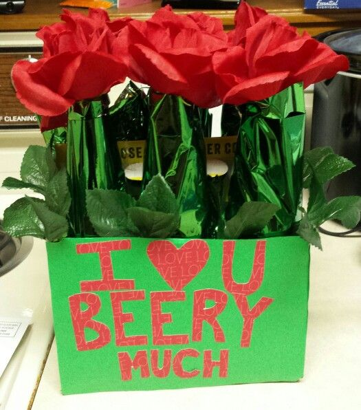 A perfect inexpensive diy boyfriend's Valentines Day gift! Create a Beer Bouquet for your beer loving partner by using fake flowers, tissue paper, & scrapbook paper from the dollar store.