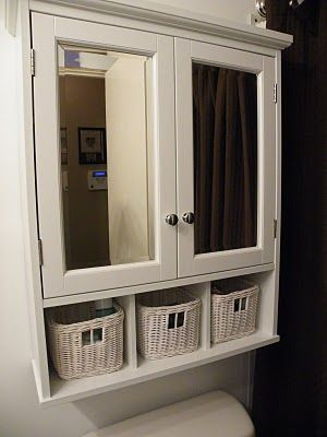 Cabinet above toilet. Great Idea.  That would be like an extra medicine cabinet, one for dad, one for mom. Baskets for extra toilet paper or something :)