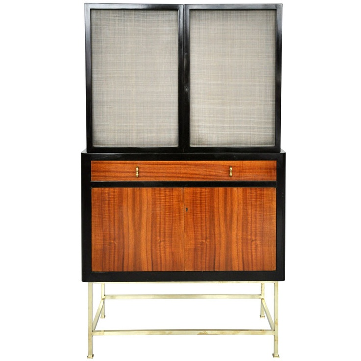 Rare bar/serving cabinet by Edward Wormley for Dunbar. Original dark finish case with Tawi wood doors and brass base. Locking lower cabinet w/ keys. Glass interior shelves on top. 1960s.