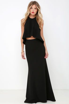 """Poised and ready for anything is what you'll feel like in the Cool, Calm, and Collected Black Two-Piece Maxi Dress! Stretch woven fabric begins at a halter neckline which fastens behind the neck with two shimmering rhinestone buttons. Sleeveless top has a fluttering high-low hem that meets the high-waisted skirt before it flows to a flaring, maxi length. Skirt has a hidden back zipper. Small top measures 17"""" long. Small bottom measures 44.5"""" long."""