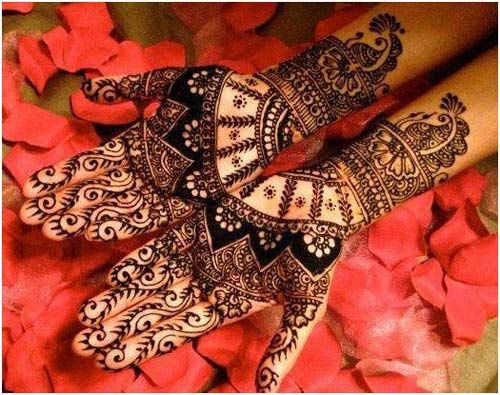 Bridal Mehndi Designs For Your Wedding Day. If you like very unique mehandi patterns, then this design will definitely catch your fancy. The design is very different from what we usually see on the hands of the bride. The designs are done with very sharp and thin lines making the designs very fine. The occasional shading and the use of modern motifs and unusual motifs make this a very unique choice for the bride.