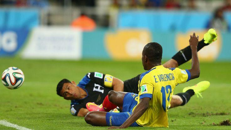 Enner Valencia of Ecuador scores his team's first goal past Noel Valladares of Honduras