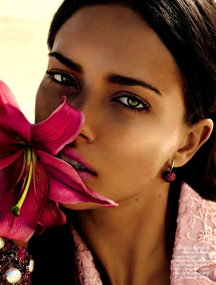 Adriana Lima by Miguel Reveriego for Vogue España May 2014.