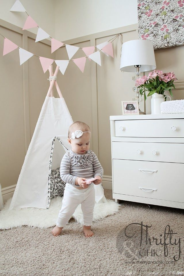 DIY 3 sided teepee. Only cost $7 to make! A cute addition to the nursery!