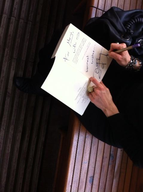 Kitap imzalarken...