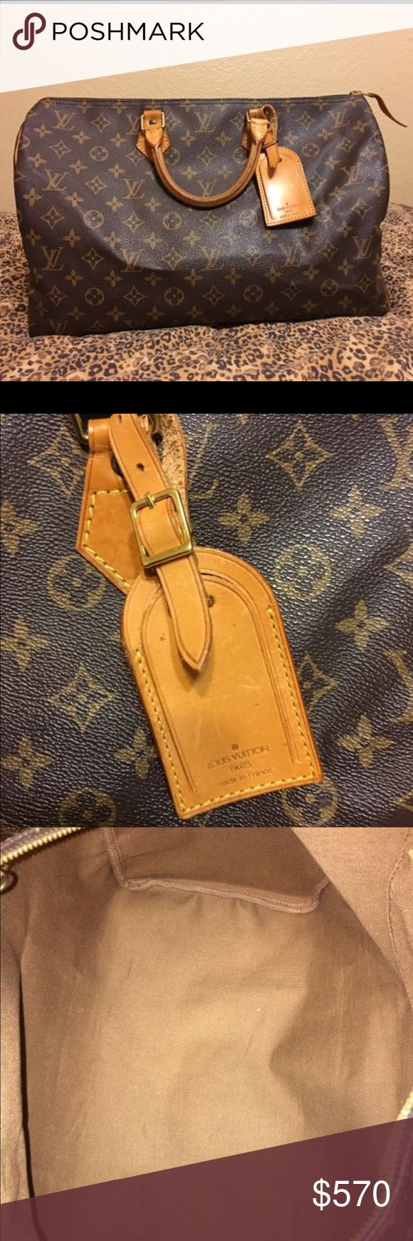 Louis Vuitton Speedy 40 Authentic LV Speedy 40. Wrinkled side tab as shown but other than that, great preloved condition!    No dustbag, no box, no receipt.    Includes luggage tag and base shaper. 🛑NO TRADES PLEASE. 🅿️🅿️ $420 free ship. Louis Vuitton Bags Satchels