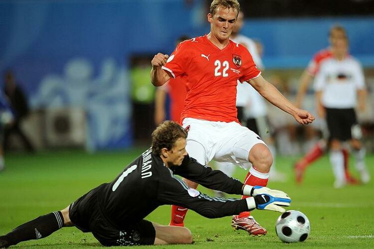 Austria 0 Germany 1 in 2008 in Vienna. Jens Lehmann gets the loose ball as Erwin Hoffer comes in at Euro 2008 in Group B.
