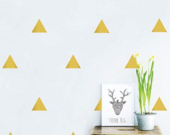 * Images show triangles that are 3 in by 3.5 in.  Want a fast way to make a huge visual impact on your walls? Our vinyl triangle decals is your ticket.  Each triangle measures approximately 3 tall by 3.5 wide  These vinyl triangles give the look of a high end paint job and work on walls, appliances or wooden furniture such as dressers or desks. Looks amazing in gold but feel free to choose from all of the colors we have available. Comes in a set of 99 stickers. Order extra sets for a big…