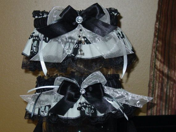 Oakland Raiders Wedding Garter Set, my honey would appreciate this... But i dont know if I can get myself to sport the raiders lol