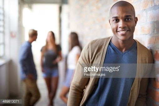 Portrait of a handsome young man with friends in the background
