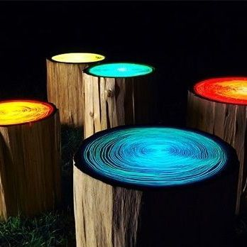 Love these log stools painted with glow in the dark paint -- great for firepit seating!