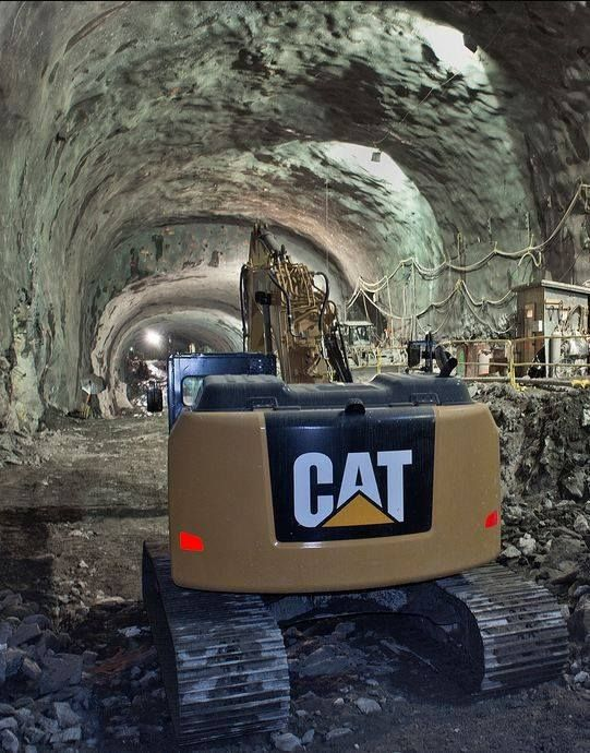 Cats enjoy spelunking. This is an excavator helping build a subway in New York City Lift Operator Training www.scissorlift.training
