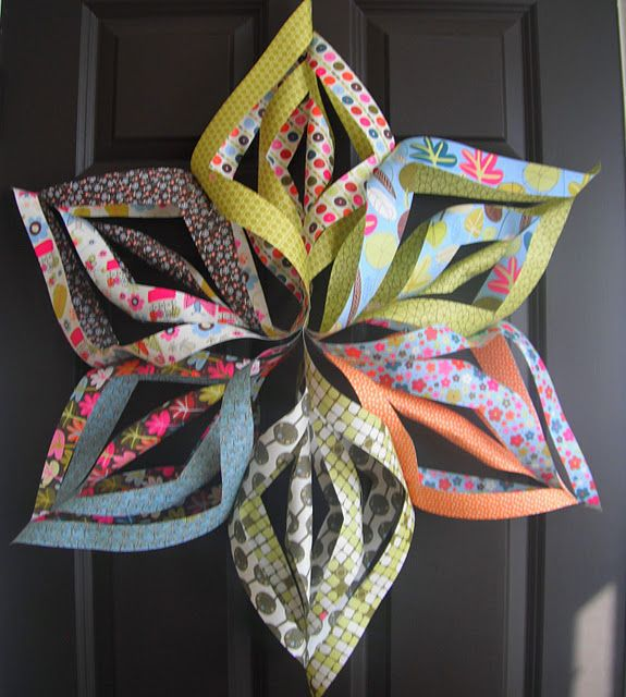 Paper star or paper flower from scrapbook paper ~ So pretty, I think these would make cool Eid decorations.