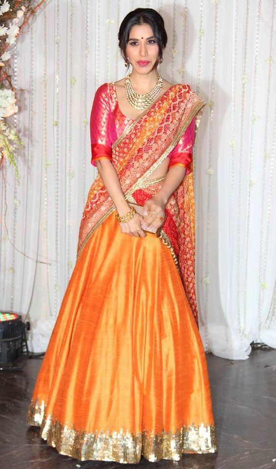 Orange and red Lehenga in raw silk with sequence work