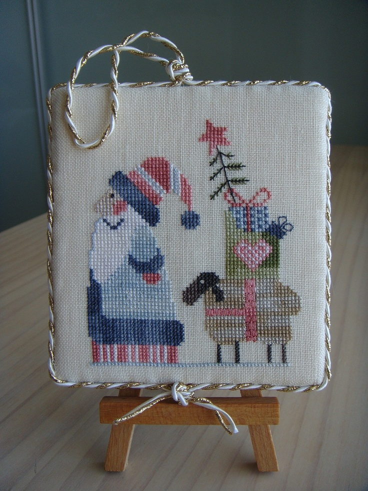 Mosey'N me....chart in 2012 Just Cross Stitch Christmas Ornaments....tap picture again and you will find a list of colors used but you will have to figure out where they go......I want to do this in the soft colors and not what is listed on the original chart......soooo pretty....