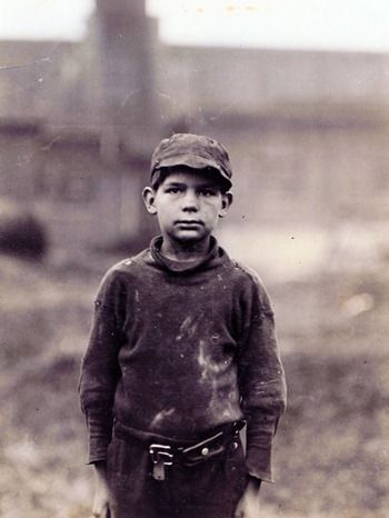"Neil Power, 10 yrs old, he said, ""Turns stockings in Rome  Hosiery Mill."" A shy, pathetic figure. ""Hain't been to school much.""    Photographed  by Lewis Wickes Hines1 in Rome, Georgia, April 1913.    Photographs from the records of the National Child Labor Committee."