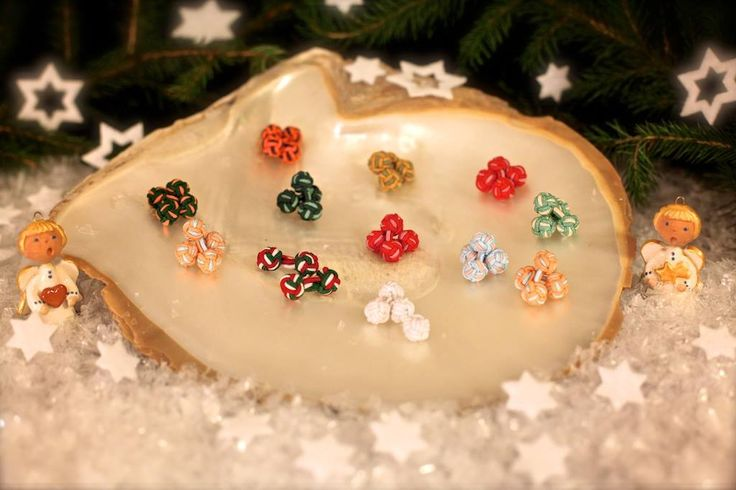 """""""On the Twelfth day of Christmas my true love sent to me Twelve Knot Links...""""  Drum up some attention with this vibrant collection of silk-knot links - Christmas ornaments for your cuffs!"""