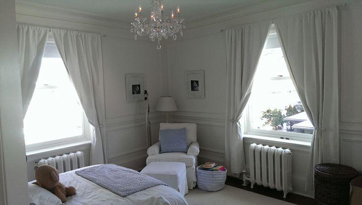 Draperies complete this cozy kid's bedroom!