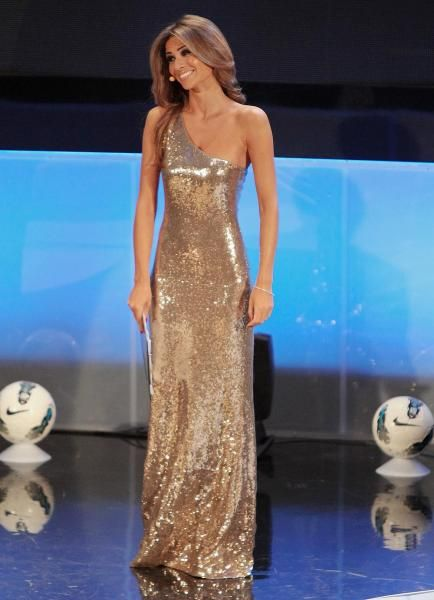 """Italian showgirl Alessia Ventura, who is dating Inzaghi, smiles during the """"Gran Gala' del calcio"""" show, where the best Serie A players are selected, in Milan, Italy, Monday, Jan. 23, 2012. (Antonio Calanni/AP)"""