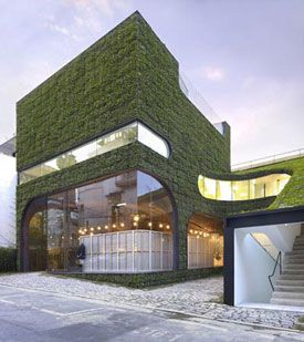 Ann Demeulemeester's Korea flagship in Seoul. Designed by Korean-based architecture firm Mass Studies, the four-level structure is a grassy oasis of nature in an otherwise gray and dense city.