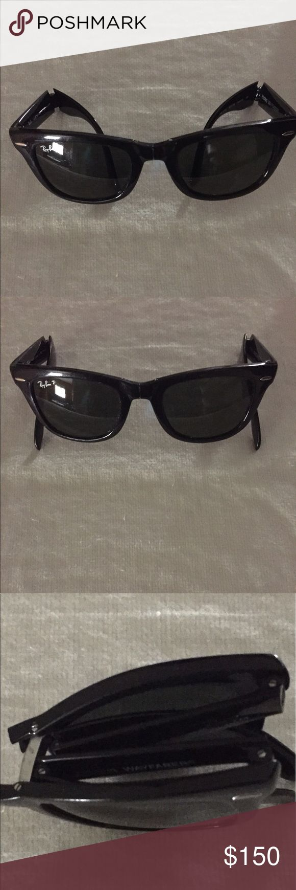 Ray-Ban Wayfarer Folding Classic Sunglasses This is a pair of polarized black frame Ray Ban folding classic sunglasses. There is a little wear on each side from normal wear and being folded while in the case as shown in the pictures. Ray-Ban Accessories Sunglasses