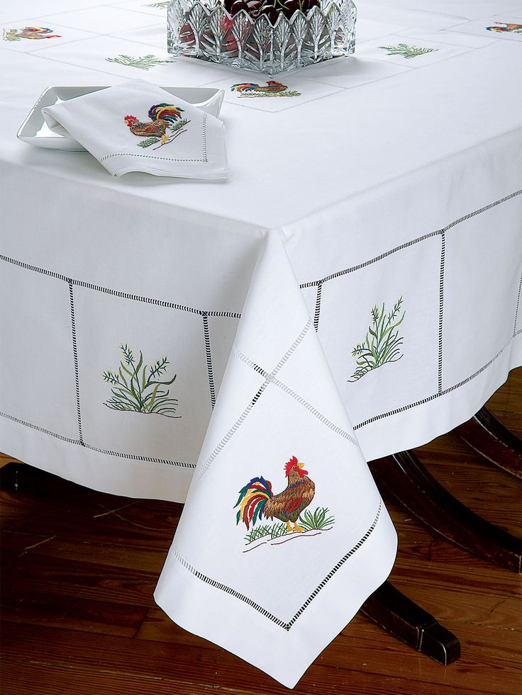 Coq au Vin - Luxury Table Cloths - With the appealing charm of a Parisian café, delightful roosters francaise are embroidered by hand, with great expertise, on White 100% linen woven in Italy. Thanksgiving Table Linens.  #SchweitzerLinen #TableLinens #TableLinen #ThanksGiving