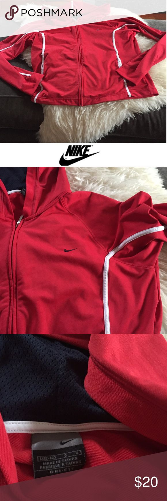 Nike Women's Red Zip Up Athletic Hoodie Nike Women's Red Zip Up Athletic Hoodie. White accent stripes. Front pockets. 24 inches long. 22 inch bust. Gently worn. Great condition. Feel free to make an offer or bundle & save! Nike Tops Sweatshirts & Hoodies