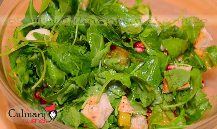 Arugula salad with pomegranate, chicken and orange on http://www.culinarywishes.com