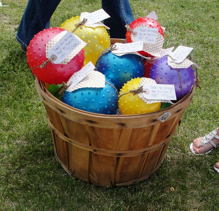 """Party favors for first birthday party.  Sensory balls- perfect for babies!  They loved them.  With gift tag attached w/ twine that says """"Thank you for coming!  Hope you have a ball!."""" Placed in farm produce basket for country charm."""