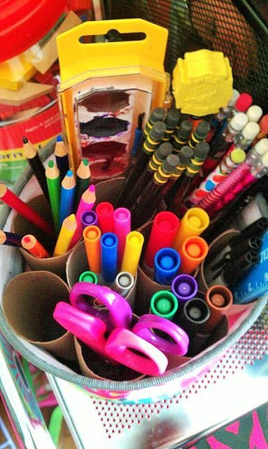 The Oh-Snap Bin keeps all of your art supplies in one place...shown here with a clever use of cardboard tissue rolls!