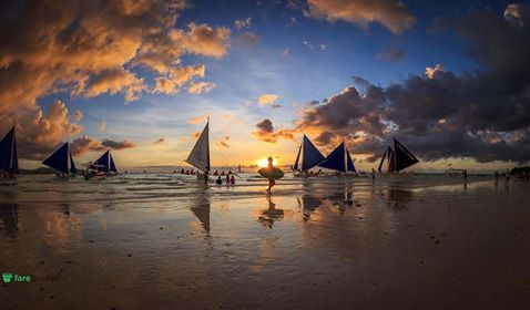 Sailboats in the sea at sunset in Boracay, Philippines.  Book your tickets to Philippines with #Farebucket