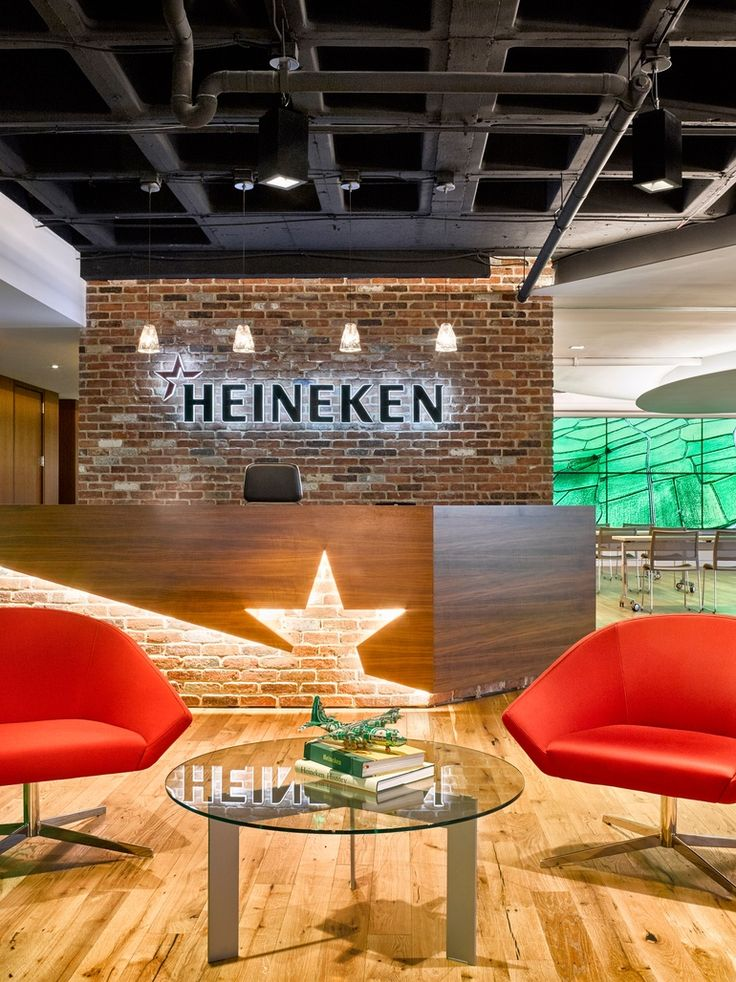 New Heineken New York HQ Office. The reception area features branding rendered in wood and brick.