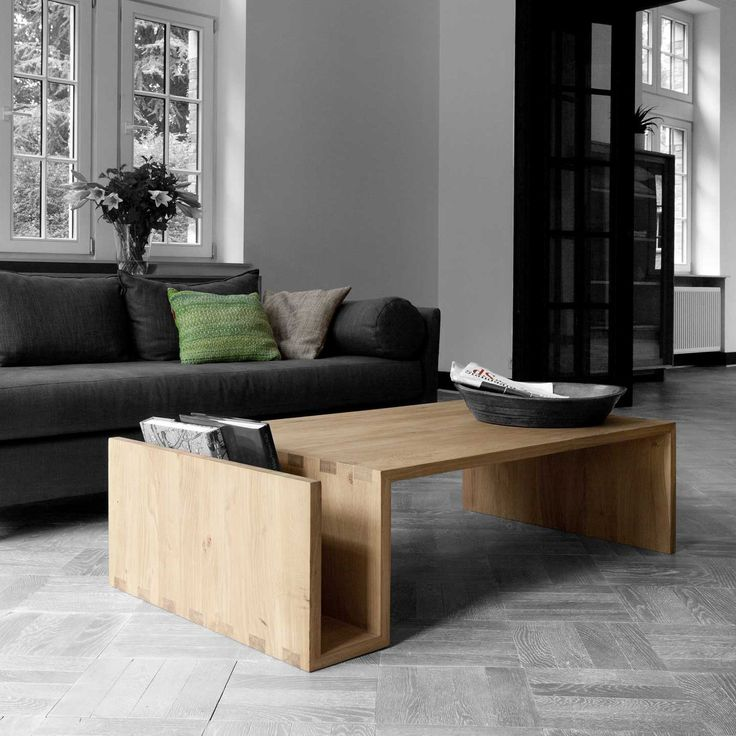 This oak coffee table by Belgian design house Ethnicraft features a unique shape that provides convenient storage for magazines and newspapers, and keeping the top free of clutter.