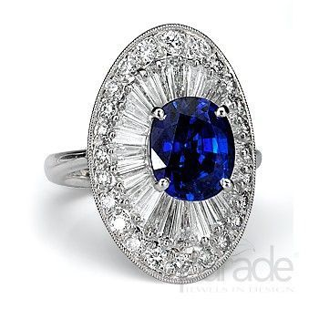 Rosamaria G Frangini | High Deep Blue Jewellery | A vibrant 4.23 carat oval-cut sapphire, all haloed by a ring of diamonds