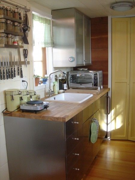 Derek's kitchen: Toaster Ovens, Tiny House Kitchens, Countertops, Tiny Kitchens, Tinyhous Kits 1, House On Wheels, Steel Cabinetri, House For Sales, Stainless Steel