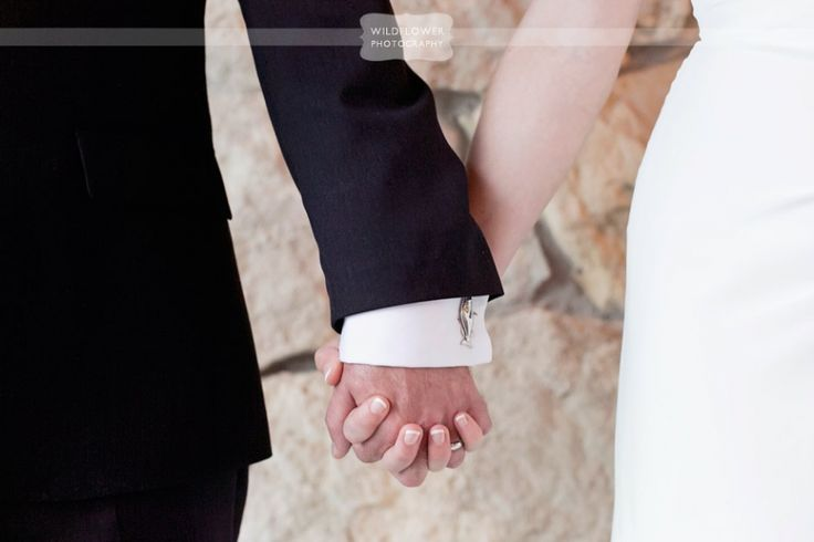 Lovely detail photo of the bride and groom holding hands, with the coolest cufflinks ever!  The groom was an avid fisherman, and he had bass cufflinks!  From a rustic wedding at the Columbia Country Club in MO.  #wildflowerphotography #columbiacountryclub