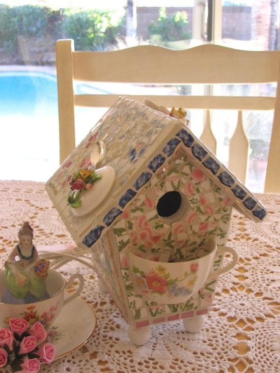i like the thought of using a tea cup on the birdhouse for birdseed or flowers.